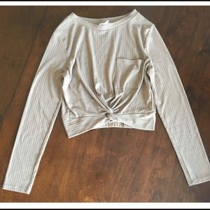 2/15$ cream top with a pocket on the front